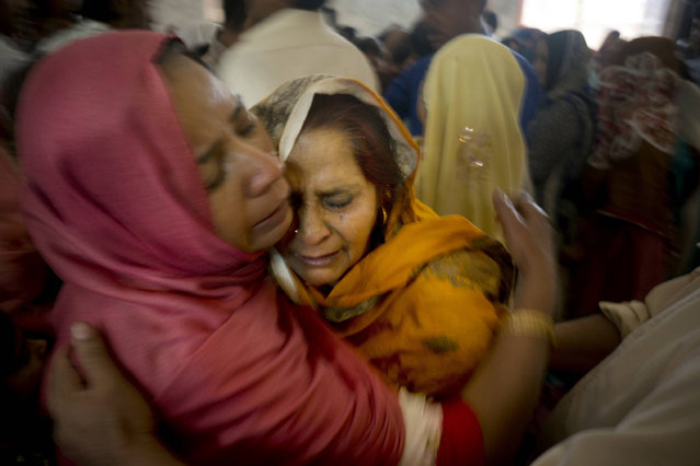 Pakistani Christian women mourn the deaths of their family members during a funeral service at a local church in Lahore, Pakistan,  Monday, March 28, 2016. (Photo by K.M. Chaudary/AP Photo)