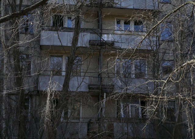 A view of the abandoned city of Pripyat is seen near the Chernobyl nuclear power plant in Ukraine on March 28, 2016. (Photo by Gleb Garanich/Reuters)