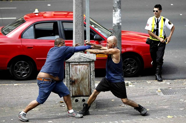 Two men fight in San Jose, Costa Rica, during the Women's Day on March 8, 2014. (Photo by Jeffrey Arguedas/EFE/SIPA Press)