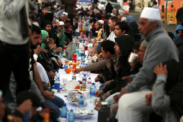 Muslims break their fast by eating the Iftar meal during the holy month of Ramadan in Bo-Kaap, Cape Town, South Africa, May 31, 2019. (Photo by Sumaya Hisham/Reuters)