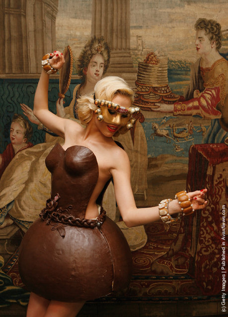 German model Alena Gerber poses wearing a full chocolate dress during the presentation of chocolate dresses