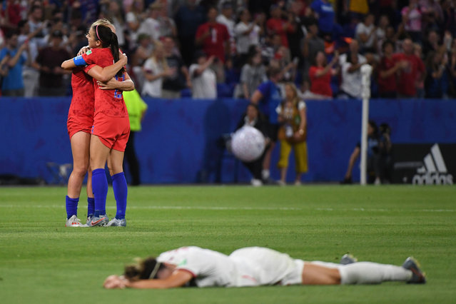 USA's players celebrate after winning the  France 2019 Women's World Cup semi-final football match between England and USA, on July 2, 2019, at the Lyon Satdium in Decines-Charpieu, central-eastern France. (Photo by Jean-Pierre Clatot/AFP Photo)