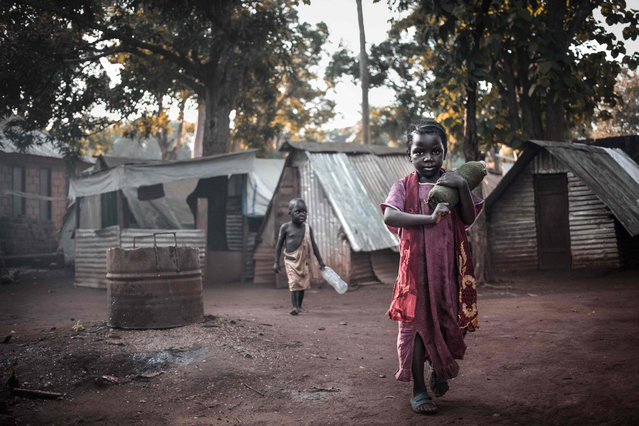 "Two children play at the site of the ""Petit Seminaire"" in Bangassou on May 17, 2019. In Bangassou, Muslim displaced persons from the IDP site known as the ""Petit Seminaire"" returned to their predominantly Muslim district of Tokoyo after two years of isolation thanks to the return of stability in the city. (Photo by Florent Vergnes/ AFP Photo)"
