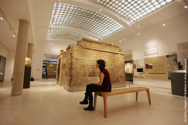 A woman views the Shrine of Taharqa in the Ashmolean Museum's new exhibition of artifacts from ancient Egypt and Nubia