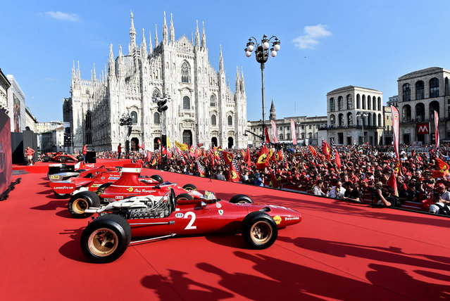 People attend an event to celebrate 90 years of Italian premium sports car maker Ferrari racing team at Milan's Duomo square, in Milan, Italy on September 4, 2019. (Photo by Flavio lo Scalzo/Reuters)