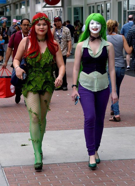 """Libby Burnette (L) of California, dressed as the Poison Ivy character from """"Batman"""", and Sophie Alman of Canada, dressed as the Joker character from """"Batman"""", arrive at preview night for Comic-Con International 2015 at the San Diego Convention Center on July 8, 2015 in San Diego, California. (Photo by Ethan Miller/Getty Images)"""