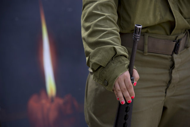 An Israeli soldier takes part in during a rehearsal for a ceremony to mark Israel's Memorial Day for fallen soldiers at the Mount of Olives cemetery in east Jerusalem, Tuesday, May 10, 2016. Israel will mark the annual Memorial Day in remembrance of soldiers who died in the nation's conflicts, beginning at dusk Tuesday until Wednesday evening. (Photo by Oded Balilty/AP Photo)