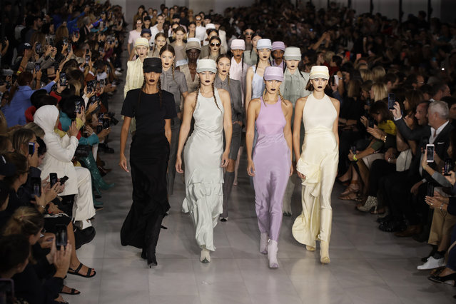Models Joan Smalls, from front left, Gigi Hadid, Bella Hadid and Kaia Gerber wear creations with other models as part of the Max Mara Spring-Summer 2020 collection, unveiled during the fashion week, in Milan, Italy, Thursday, September 19, 2019. (Photo by Luca Bruno/AP Photo)