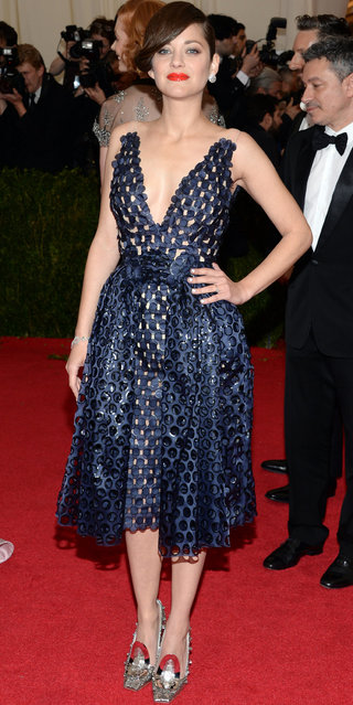 "Marion Cotillard attends The Metropolitan Museum of Art's Costume Institute benefit gala celebrating ""Charles James: Beyond Fashion"" on Monday, May 5, 2014, in New York. (Photo by Evan Agostini/Invision/AP Photo)"