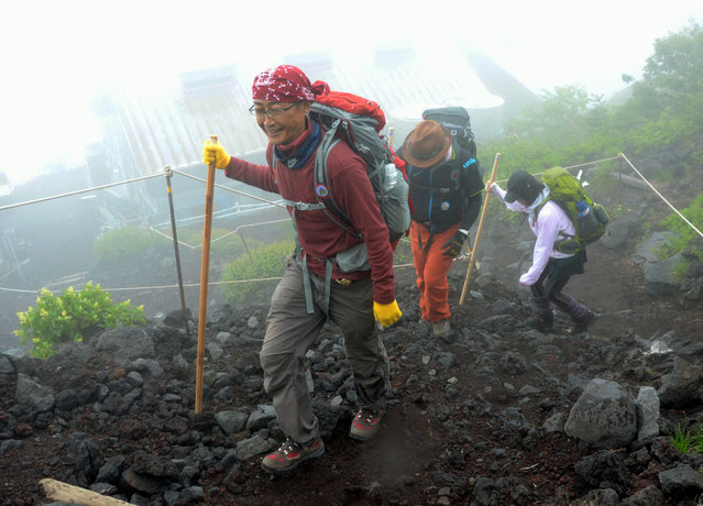 Climbers make their way as a route to climb Mount Fuji on the Shizuoka prefecture side opened for climbing season in Fujinomiya, Shizuoka prefecture, central Japan Friday, July 10, 2015. Climbers who reach the summit of Mount Fuji will now be able to share their achievement via free Wi-Fi. A Japanese mobile phone network says it will begin offering free Wi-Fi Friday at eight hotspots on Japan's most famous mountain, including the 3,776-meter (12,389-foot) summit. (Photo by Kyodo News via AP Photo)
