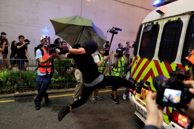 A protester kicks a police vehicle at a demonstration at Taikoo station in Hong Kong, China on October 3, 2019. (Photo by Jorge Silva/Reuters)