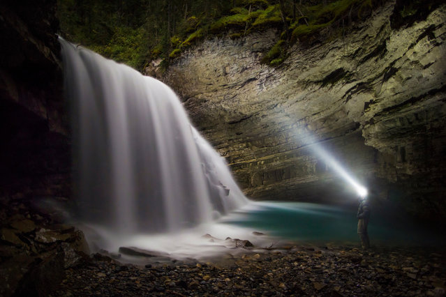 "Paul Zizka in ""Night At The Canyon"", Johnson Canyon, Banff National Park, September 17, 2013. (Photo by Paul Zizka/Caters News)"