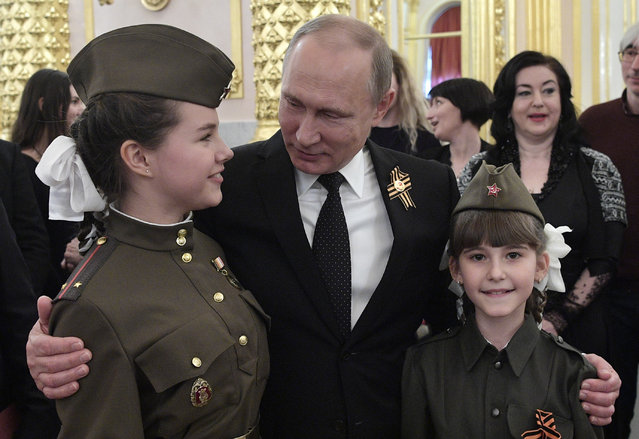 "The Russian president, Vladimir Putin, greets guests at a reception at the Moscow Kremlin to mark the 72nd anniversary of the victory over Nazi Germany in the ""Great Patriotic War"" of 1941-1945 on May 9, 2017. (Photo by Alexei Nikolsky/TASS)"