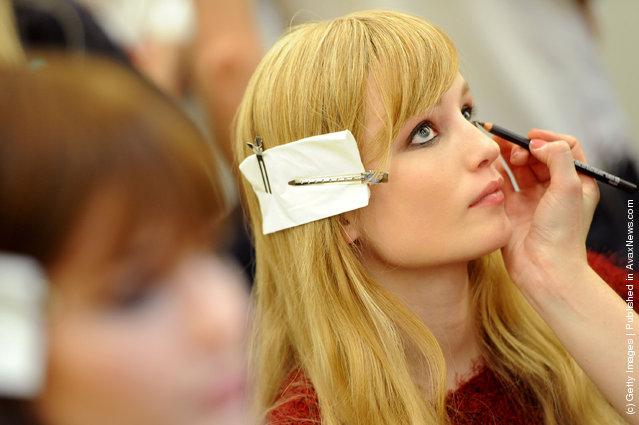 A model prepares prepares backstage at the Iceberg Autumn/Winter 2012/2013 fashion show as part of Milan Womenswear Fashion Week