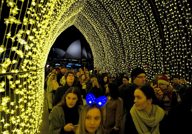 A crowd walks into the 'Cathedral of Light' near the Sydney Opera House during the opening night of the annual Vivid Sydney light festival in Sydney, Australia May 27, 2016. (Photo by Jason Reed/Reuters)