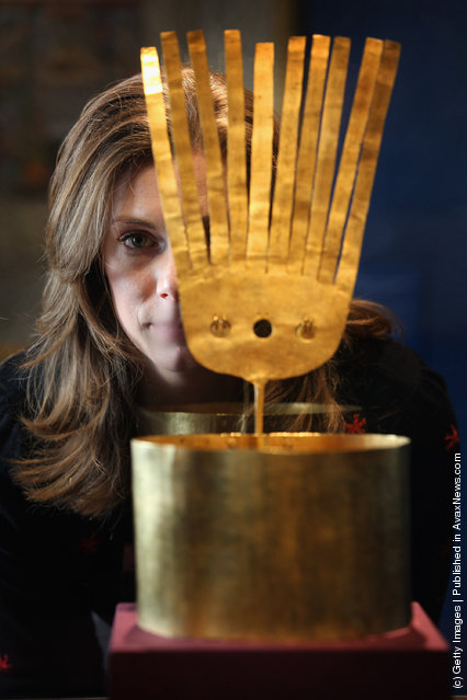 Alice Ross views a gold crown which was presented to Queen Victoria, part of the Royal Collection on display at the Queens Gallery