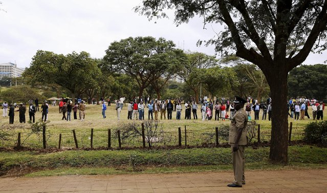 People watch along the route as U.S. President Barack Obama travels to participate in a bilateral meeting with Kenya's President Uhuru Kenyatta at the State House in Nairobi, Kenya July 25, 2015. (Photo by Jonathan Ernst/Reuters)