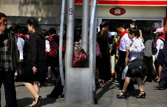 North Korean school children and office workers make their way along a busy sidewalk, Monday, May 4, 2015 in Pyongyang, North Korea. (Photo by Wong Maye-E/AP Photo)