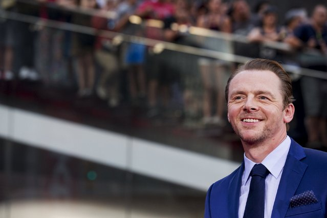 """Actor Simon Pegg poses on the red carpet for a screening of the film """"Mission Impossible: Rogue Nation"""" in New York July 27, 2015. (Photo by Brendan McDermid/Reuters)"""