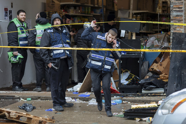 Responders work to clean up the scene of Tuesday's shooting that left multiple people dead at a kosher market on Wednesday December 11, 2019, in Jersey City, N.J. (Photo by Kevin Hagen/AP Photo)