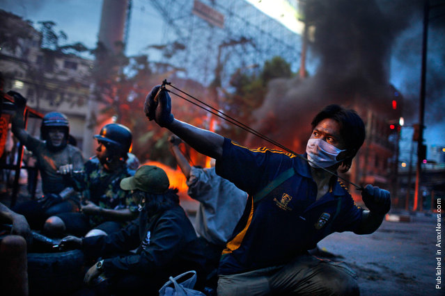 World Press Photo winner of the 2nd prize Spot News Stories of the 2011 World Press Photo contest by Corentin Fohlen, France, Fedephoto, of anti-government riots in Bangkok, Thailand, May 2010