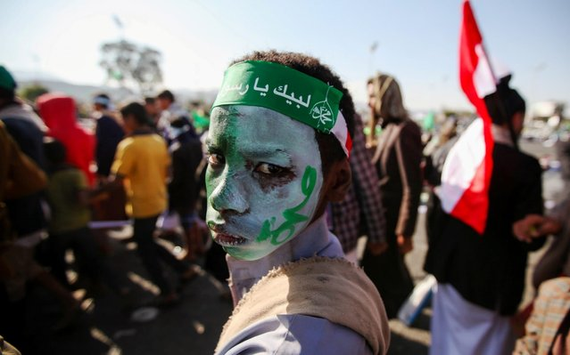 """A man looks on as he attends a rally to mark the birthday of the Prophet Muhammad in Sanaa, Yemen on November 9, 2019. The headband reads: """"Oh Messenger of Allah!"""". (Photo by Khaled Abdullah/Reuters)"""