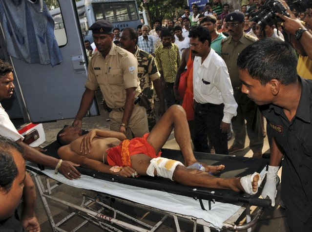 A man, who was injured in a stampede, is taken to a hospital in Ranchi, Jharkhand, India, August 10, 2015. A surging crowd near a Hindu temple killed at least ten people and injured 25 others in the eastern Indian state of Jharkhand on Monday, police said. The stampede at Deoghar town occurred when pilgrims gathered on a day considered auspicious for the temple's goddess, local police chief P. Murugan told Reuters. (Photo by Reuters/Stringer)
