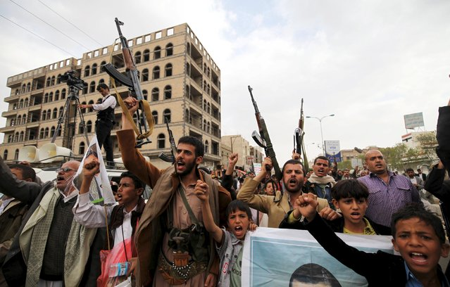 Followers of the Houthi movement raise their rifles as they shout slogans during a rally against the Saudi-led coalition in Yemen's capital Sanaa, August 11, 2015. (Photo by Mohamed al-Sayaghi/Reuters)