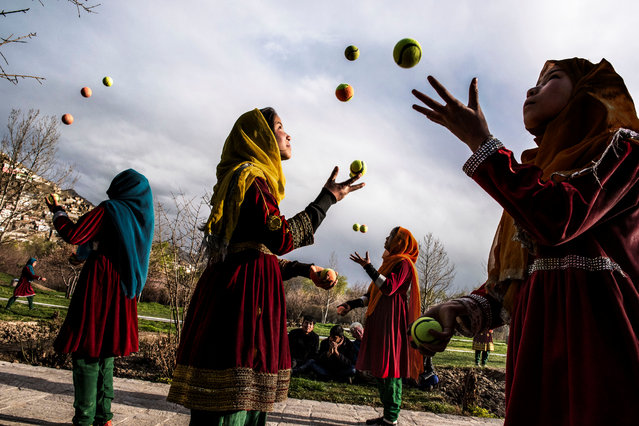 Kabul, 2016. A group of Afghan girls juggle tennis balls in the streets of the capital. (Photo by  Steve McCurry/Taschen/Magnum Photos/The Guardian)