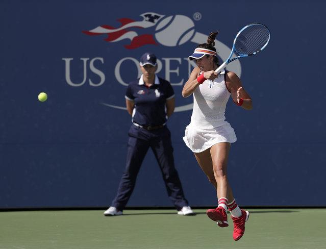 Garbine Muguruza, of Spain, returns a shot from Magdalena Rybarikova, of Slovakia, during the third round of the U.S. Open tennis tournament, Friday, September 1, 2017, in New York. (Photo by Michael Noble Jr./AP Photo)