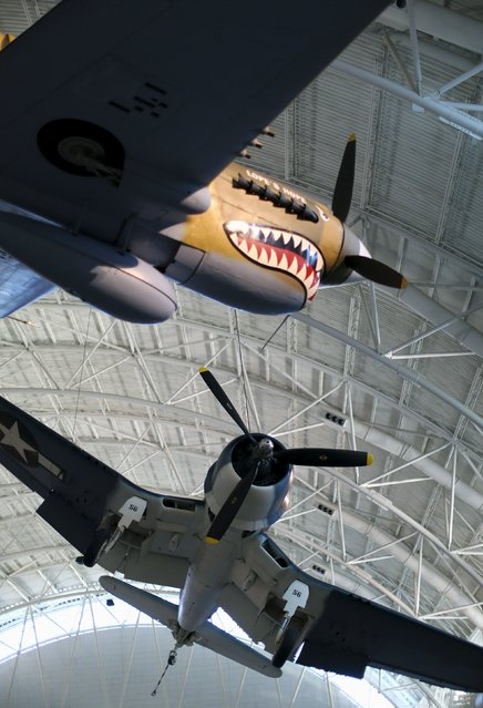 World War Two vintage Curtis P-40 Flying Tiger (L) and a Vought F4U-1D Corsair (R) aircraft are seen at the Udvar-Hazy Smithsonian National Air and Space Annex Museum in Chantilly, Virginia August 28, 2015. (Photo by Gary Cameron/Reuters)