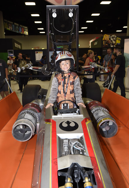 Tank Castellanos stands in the cockpit of the life-sized Hot Wheels X-wing Fighter Carship during Preview Night at Comic-Con International held at the San Diego Convention Center Wednesday July 20, 2016 in San Diego. (Photo by Denis Poroy/Invision/AP Photo)
