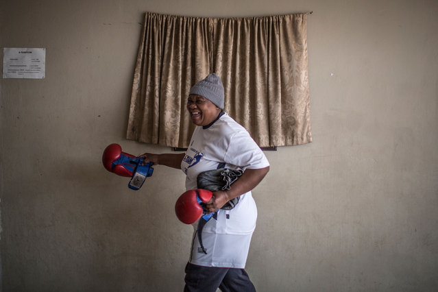 "Gladys Ngwenya gets ready for the Boxing Gogos training session hosted by the ""A Team Gym"" in Cosmo City in Johannesburg on September 19, 2017. (Photo by Gulshan Khan/AFP Photo)"