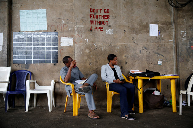 Entrepreneur Bilikis Adebiyi-Abiola (R) sits with a guest at her Wecycler waste recycling centre in Ebutte Meta district in Lagos,Nigeria July 28, 2016. (Photo by Akintunde Akinleye/Reuters)