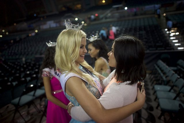 Miss Nevada Outstanding Teen Lauren Watson, 16, embraces a friend after the first night of preliminaries of the Miss America Pageant at Boardwalk Hall in Atlantic City, New Jersey, September 8, 2015. (Photo by Mark Makela/Reuters)