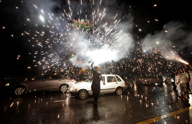A man holds fireworks during the country's Independence Day celebrations in Islamabad, Pakistan, August 14, 2016. (Photo by Faisal Mahmood/Reuters)