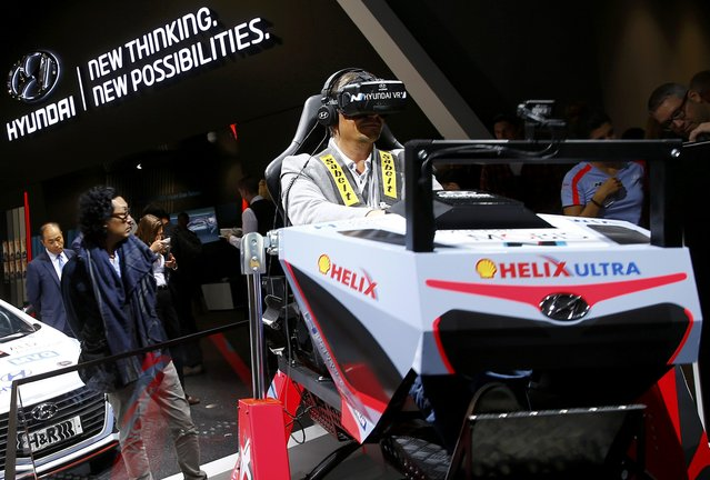 A visitor uses the Hyundai Virtual Drive Simulator during the media day at the Frankfurt Motor Show (IAA) in Frankfurt, Germany September 15, 2015. (Photo by Kai Pfaffenbach/Reuters)