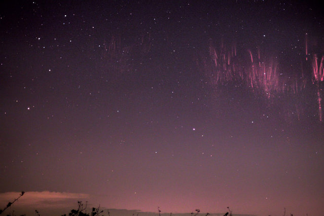 These spectacular pictures show the incredible moment a rare natural phenomenon happens in the night sky. Red sprite lightning lasts only a millisecond and takes place high above a tunderstorm cloud.The breathtaking flashes of light are caused by huge electrical discharges of lightning in the sky. Marko Korosec, 32, was lucky enough to catch these sprites on camera after months of trying. Mr Korosec, from Sezana in Slovenia, took the shots whilst he was following storms in Vivaro, Italy. (Photo by Marko Korosec/Solent News/SIPA Press)