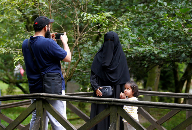 Tourists from the Middle East take pictures at Vrelo Bosne nature park in Ilidza near Sarajevo, Bosnia and Herzegovina, August 19, 2016. (Photo by Dado Ruvic/Reuters)