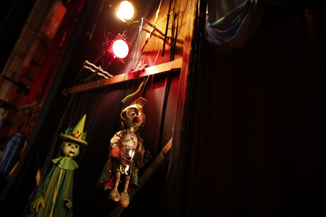 Marionettes backstage before a performance at the Bob Baker Marionette Theater in Los Angeles, California October 17, 2014. (Photo by Lucy Nicholson/Reuters)