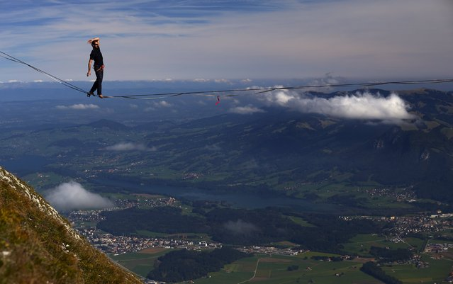 Guillaume Rolland of France walks on the line during the Highline Extreme event in Moleson, Switzerland September 25, 2015. (Photo by Denis Balibouse/Reuters)
