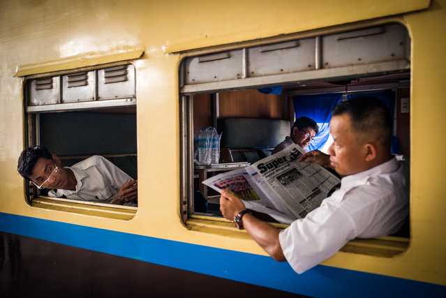 """Breaking News"". First class travellers are getting ready for a hot and humid 18 hours train ride from Yangon to Bagan. Photo location: Yangon, Myanmar. (Photo and caption by Antoine Bruneau/National Geographic Photo Contest)"