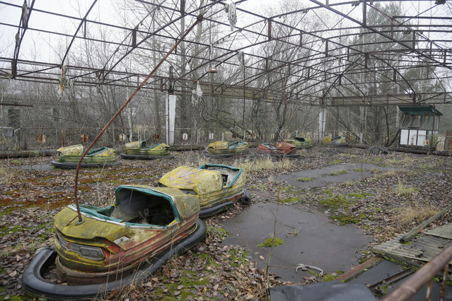 A playground in the deserted town of Pripyat, Ukraine, some 3 kilometers (1.86 miles) from the Chernobyl nuclear power plant Ukraine, November 27, 2012. (Photo by Efrem Lukatsky/AP Photo)