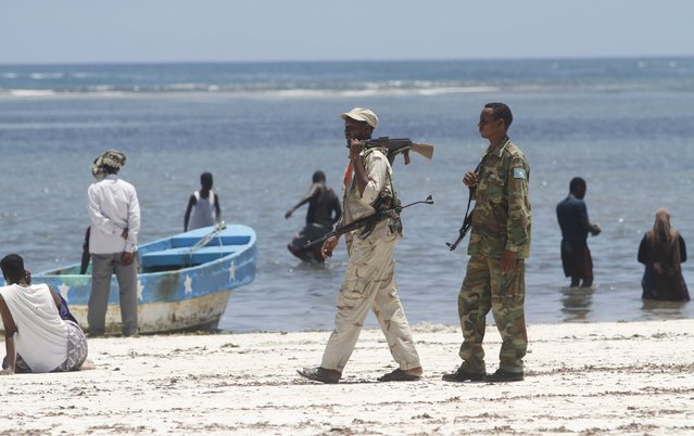 Somali government forces patrol along the Jazeera beach in southern Mogadishu, October 2, 2015. (Photo by Feisal Omar/Reuters)