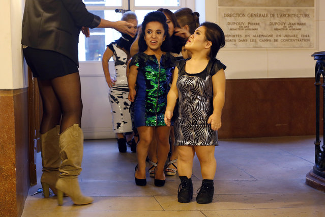 Models get lined-up before hitting the catwalk at the French Ministry of Culture during the dwarf fashion show  in Paris, France, Friday October 2, 2015. (Photo by Jerome Delay/AP Photo)