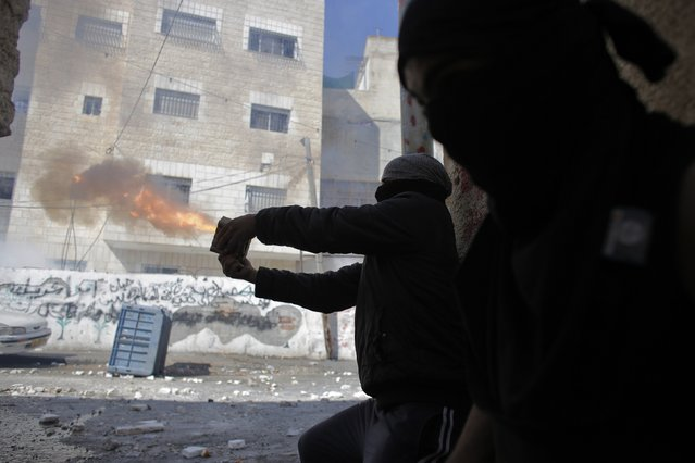Palestinians aim fireworks towards Israeli police forces during clashes in Abu Tor neighborhood at east Jerusalem October 30, 2014. Israeli police shot dead a Palestinian on Thursday after he fired at them resisting arrest in East Jerusalem hours after the attempted assassination of a far-right Israeli activist, police said. (Photo by Ammar Awad/Reuters)
