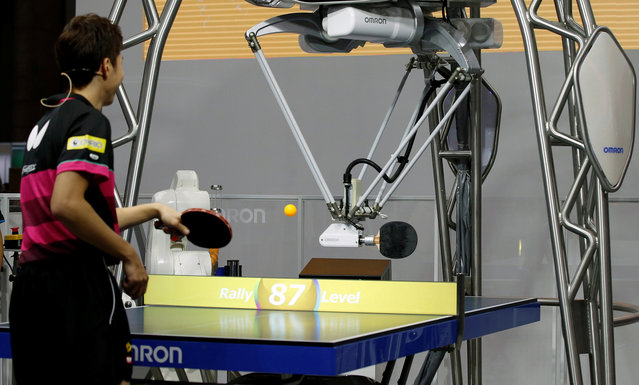 """Omron Corp. demonstrates its fourth-generation table tennis robot """"Forpheus"""" playing with table tennis Olympic medalist Jun Mizutani at CEATEC (Combined Exhibition of Advanced Technologies) JAPAN 2017 at the Makuhari Messe in Chiba, Japan October 2, 2017. (Photo by Toru Hanai/Reuters)"""