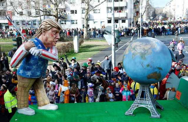"""A carnival float depicting U.S. President Donald Trump at the traditional """"Rosenmontag"""" Rose Monday carnival parade in Mainz, Germany on February 12, 2018. (Photo by Ralph Orlowski/Reuters)"""