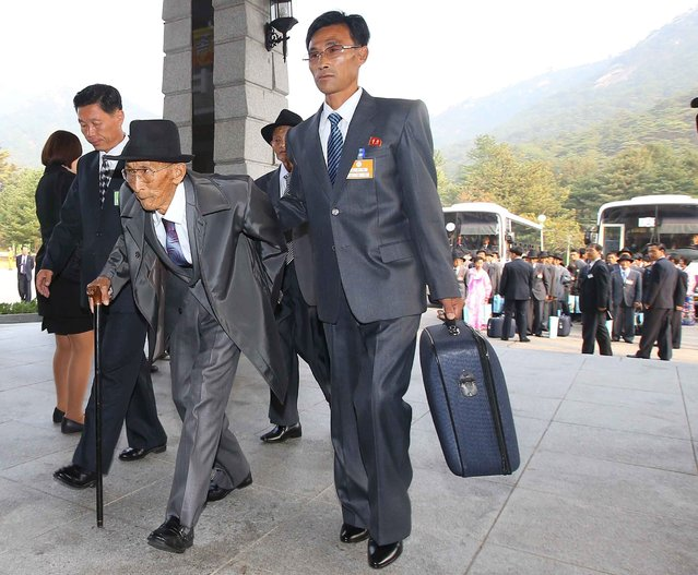 North Korean Lee Joo Il, 86, arrives to meet with his South Korean family members during a reunion for separated families at Mount Kumgang resort, North Korea, October 21, 2015. (Photo by Reuters/Yonhap)