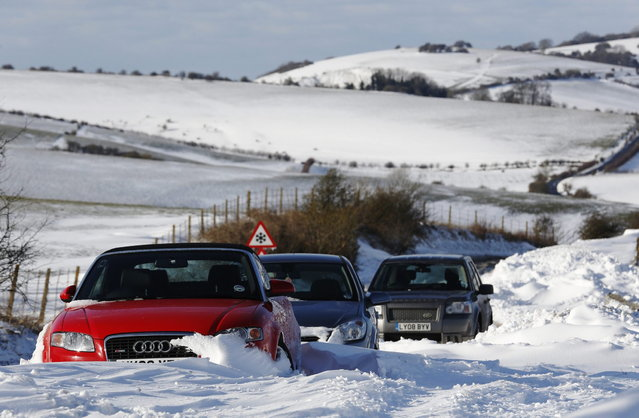 Cars remain stuck in snow on the South Downs near Brighton in southern England March 12, 2013. Drivers were left stranded  on Tuesday following a second day of heavy snowfall in southern England. (Photo by Luke MacGregor/Reuters)